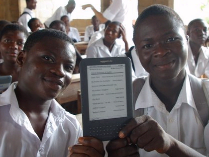 Two boys in Ghana Africa with WorldReader Amazon Kindle