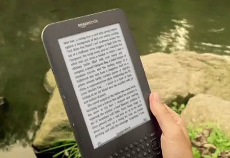 Kindle screen in TV ad by stream reading Ralph Ellison ebook Invisible Man