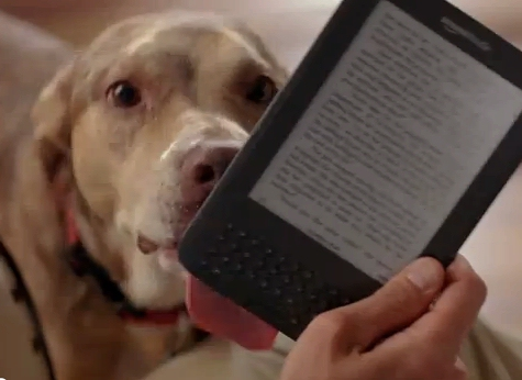 Dog licking a Kindle from Amazon TV ad