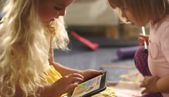 Two children play with a touchscreen Kindle in Amazon's new TV ad