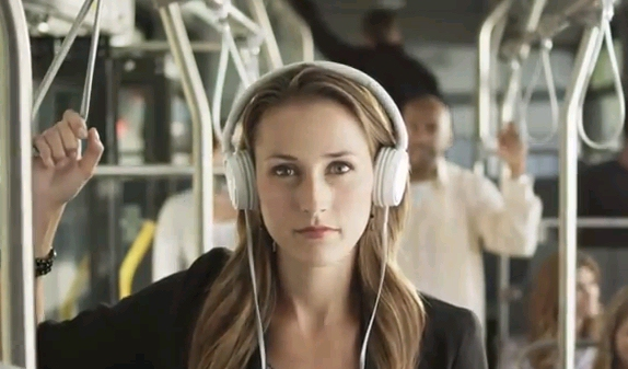 Commuting woman in Amazon Audible audiobook ad showing WhisperSync for voice